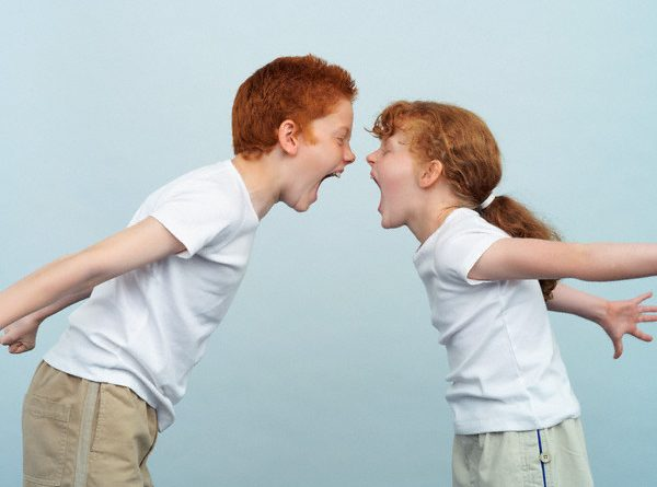 Brother and Sister Shouting at Each Other --- Image by © Norbert Schaefer/CORBIS
